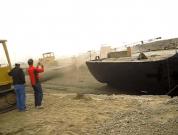 Raw Video: Barge Pulls Bulldozer Into the Water During Launching