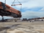 Raw Video: Large Locomotive Dropped While Unloading From Ship