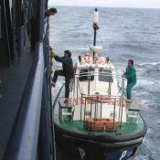 Pilot boarding a ship from a pilot boat, prior to entering a harbour (Image credits : Danny Cornelissen)