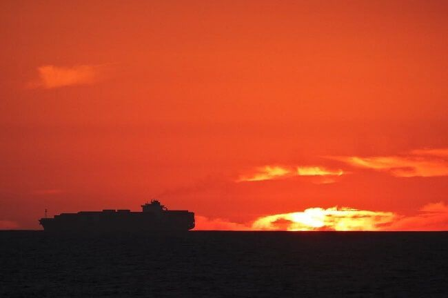 silhouette sunset container ship