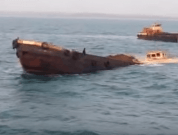 Watch: Raw Video Of Loaded Barge Sinking