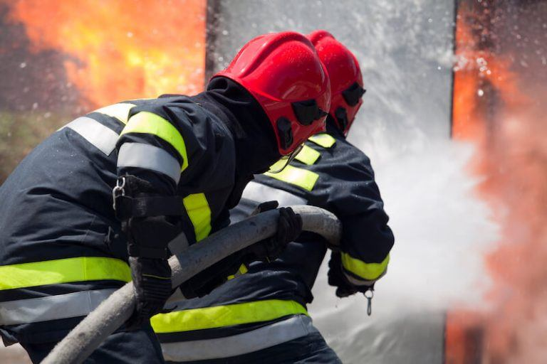 Fighting Fire In Ship's Cargo Hold At Port
