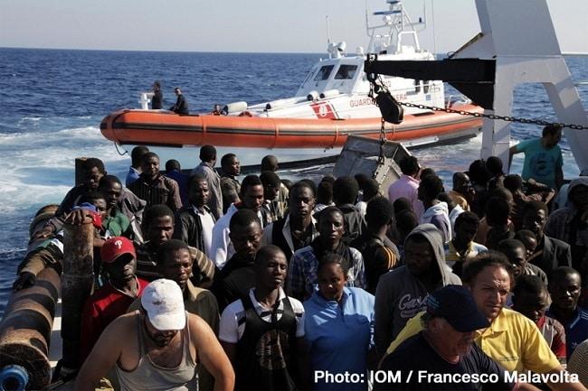 The Italian Harbourmaster Corps (Coast Guard) in Rome rescues migrants bound to the coasts of Italy. © Francesco Malavolta 2014 The Italian Coast Guard rescues migrants bound for Italy. © Francesco Malavolta/IOM 2014