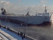 Watch: A Frozen Ice-Covered Ship Arrives In Duluth Port