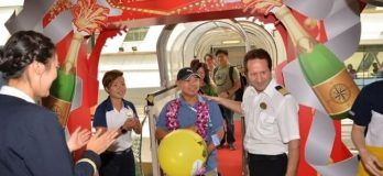 Royal-Caribbean-crew-surprises-its-millionth-guest