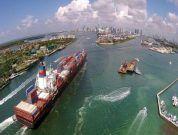 Cargo ship enters port of Miami-Dade aerial view