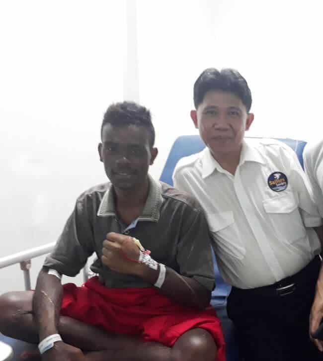 Riski with Sailors Society port chaplain Harry Rumagit