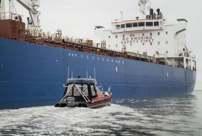 Pilot with sailing drone deployed for depth inspection of ships at locks