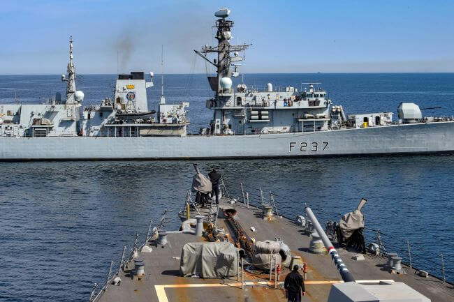 guided-missile destroyer USS Gravely (DDG 107) and the Royal Navy frigate HMS Westminster (F 237) conduct a towing approach exercise