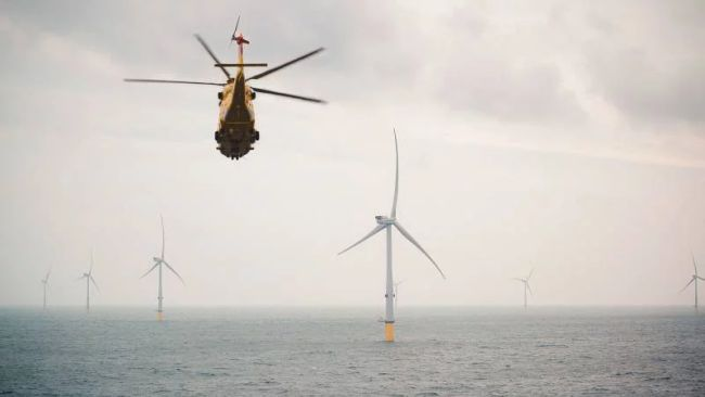 helicopter-with-hrh-crown-prince-of-denmark-over-vattenfalls-horns-rev-3-turbines