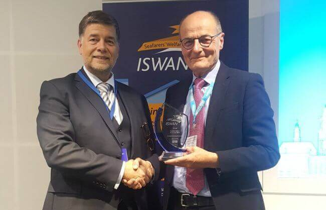 Ronald-Spithout-President-of-Inmarsat-presents-ISWAN-award-to-Liverpool-Seafarer-Centre-CEO-John-Wilson-September-2019-2