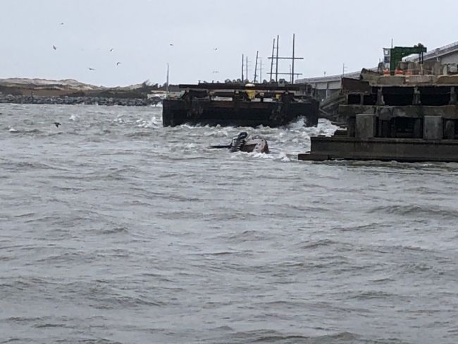 Coast Guard is responding to a discharge of diesel from a semi-submerged tugboat in the vicinity of the Old Bonner Bridge in Oregon Inlet, Monday