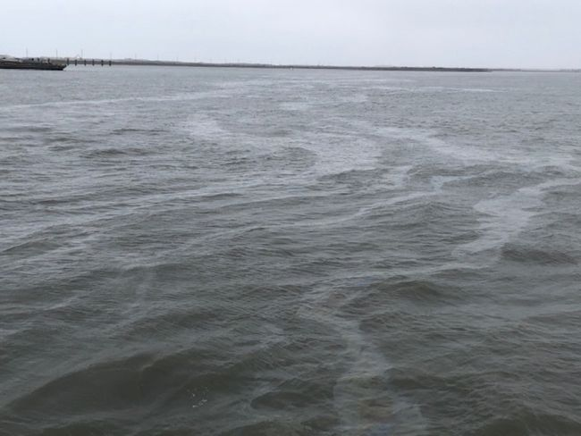 Coast Guard is responding to a discharge of diesel from a semi-submerged tugboat