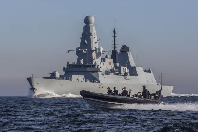 HMS Defeneder carries out boarding ops exercise.