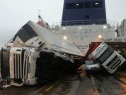 Toppled trucks and crushed van on deck