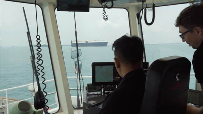 PSA Marine Tug Master and Thomas monitoring how the smart navigation system manouevres the harbour tug during sea trials