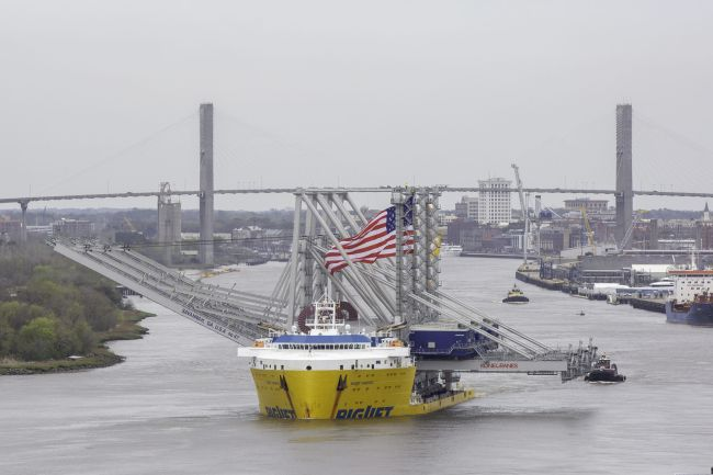 Three Neo-Panamax cranes arrive at the Port of Savannah aboard the BigLift Barentsz on Tuesday, March 10, 2020. When fully assembled, the cranes will stand 295 tall, with booms reaching 22 containers across. (Georgia Ports Authority/Emily Goldman)