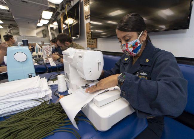 Sailors make cloth face masks