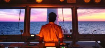 Anglo-Easter Univan Group Seafarer Standing At Bridge
