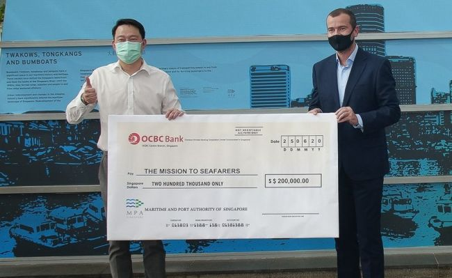 cheque presentation to Mission to seafarers MPA Singapore