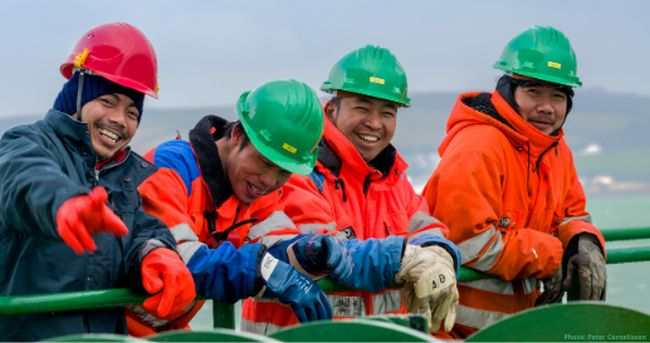 crew members laughing and enjoying