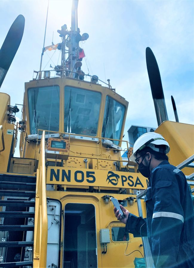 PSA Marine Engineering Officer updating BV surveyor over smart mobile device