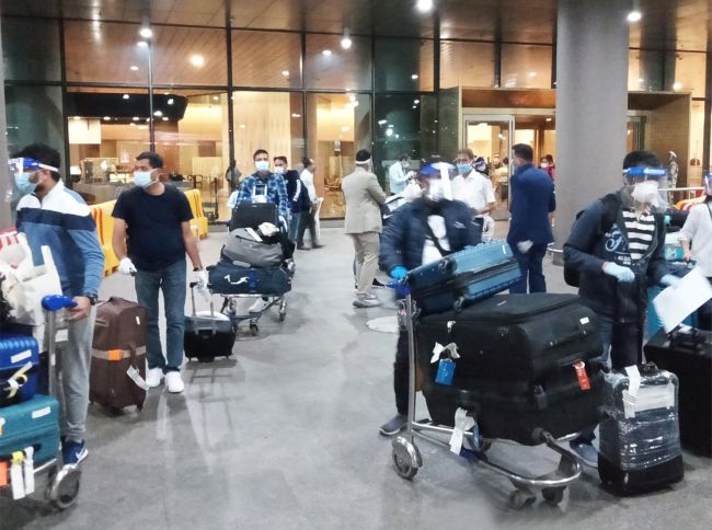 Crew members arriving at Mumbai International Airport