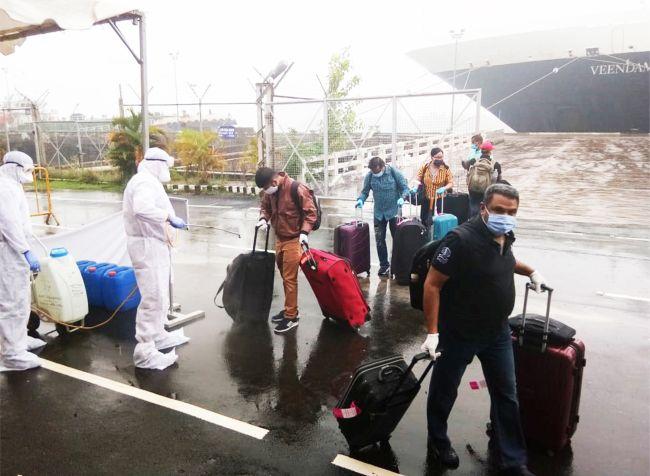 Crew members disembarking from a cruise ship in Cochin