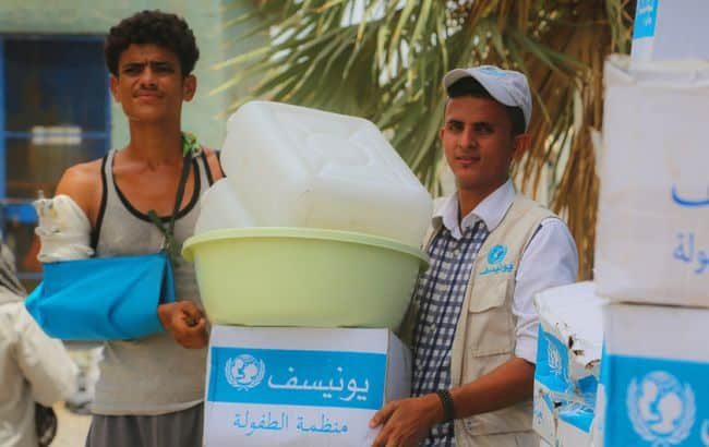 UNICEF-supported emergency humanitarian supplies are distributed in Hudaydah in June 2018
