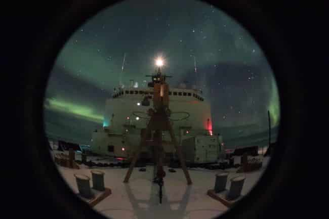 Coast Guard Cutter Healy conducts their Arctic West Summer 2018 science mission with the northern lights visible above the ship while in the Arctic Ocean