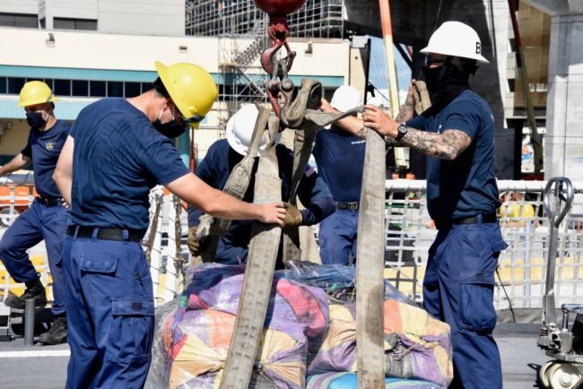 The Coast Guard Cutter Hamilton (WMSL 753) crew members offload approximately 11,500 pounds of cocaine and approximately 17,000 pounds of marijuana,