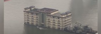 5 storey building restaurant floating downstream in china _ non text