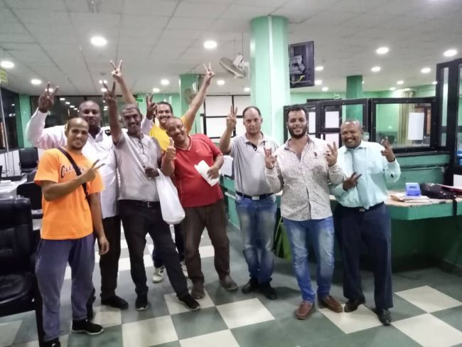 The crew of the MV Nader at the bank in Port Sudan City where they finally received their unpaid wages. | SOURCE: ITF