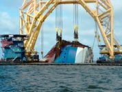 Anchor chain-attached-to-the-pulley-system-on-the-VB-10000-heavy-lift-vessel-moves-slowly-to-cut-through-Section-One-of-the-Golden-Ray-wreck.-St.-Simons-Sound-Incident-response