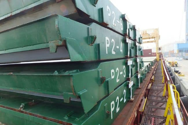 Starboard walkway showing stack of hatch covers and gantry crane