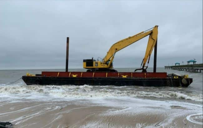 The YD71 aground after breaking free from its mooring and prior to striking the pier.