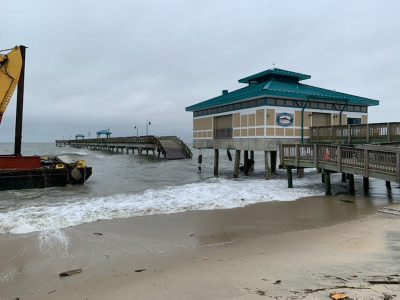 The damaged fishing pier with debris on the deck of the YD 71. (Source: Coast Guard)
