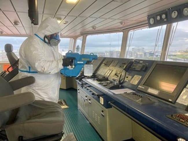 Specialist DisinfectYour.com team members on board a vessel