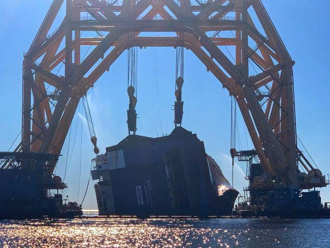 Cutting operations continue as responders separate Section Eight from the Golden Ray wreck