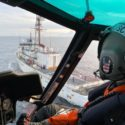 An MH-65 Dolphin helicopter crew based out of Air Station Kodiak and deployed aboard Cutter Alex Haley, prepares for a helicopter in-flight refueling at sea evolution with the cutter crew during a search and rescue case near Dutch Harbor, Alaska, Wednesday, Dec. 30, 2020. The crew hoisted an injured fisherman from the vessel Magnus Martens and placed him in the care of awaiting Guardian Flight Alaska personnel for further transport to Anchorage.