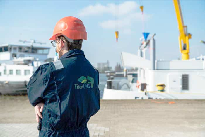 Crew member attends the COVID-secure christening ceremony
