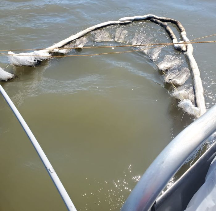 A close-up image of a sorbent boom outrigger used by response vessels to recover oil sheens in the vicinity of the Golden Ray wreck during Section Seven lifting operations on Monday