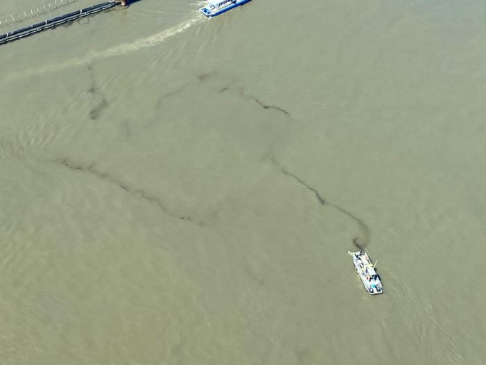A skimmer vessel collects oil material during operations to lift Section Seven of the Golden Ray wreck on Monday. St. Simons Sound Incident response photo