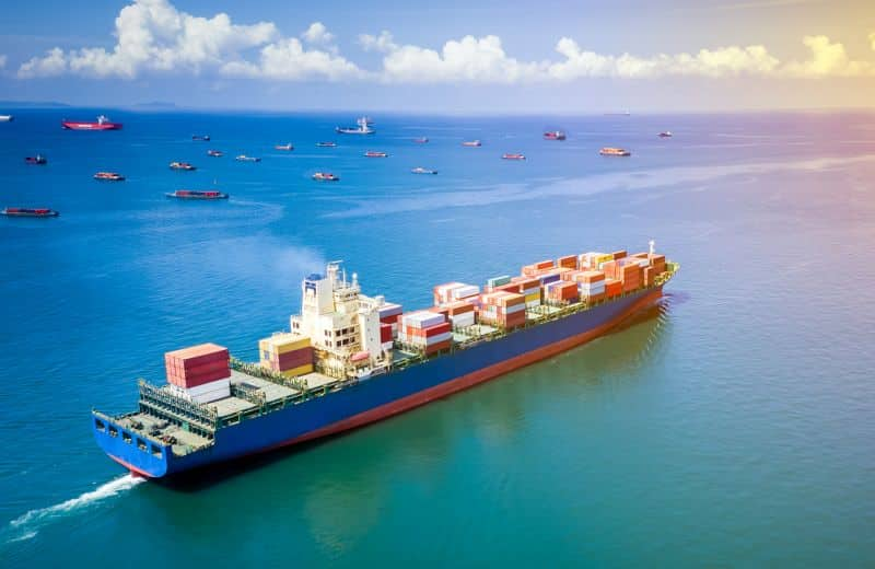 shipping container cargo industry business international inport ans export consumer product open sea aerial view