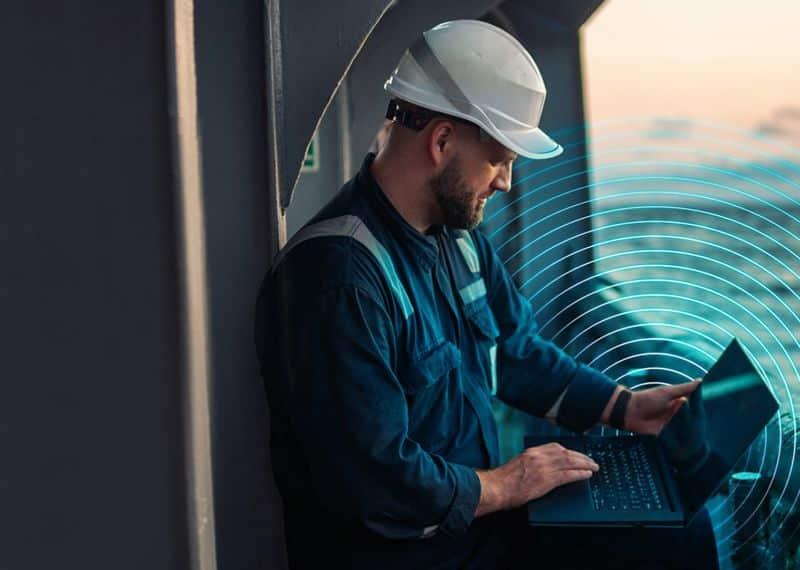 Seafarer using internet - laptop - computer