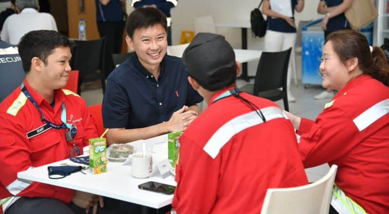 Senior Minister of State for Transport and Foreign Affairs, Mr Chee Hong Tat, speaking to frontliners from Jurong Port