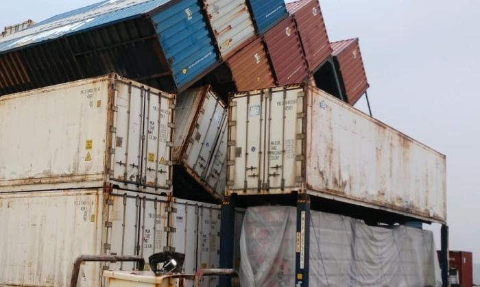 The collapsed row of containers on the barge Ho'omaka Hou in Hilo, Hawaii