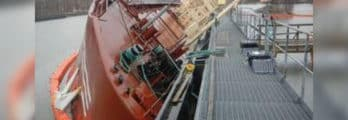 Aground,-then-punctured,-a-vessel-turns-sideways