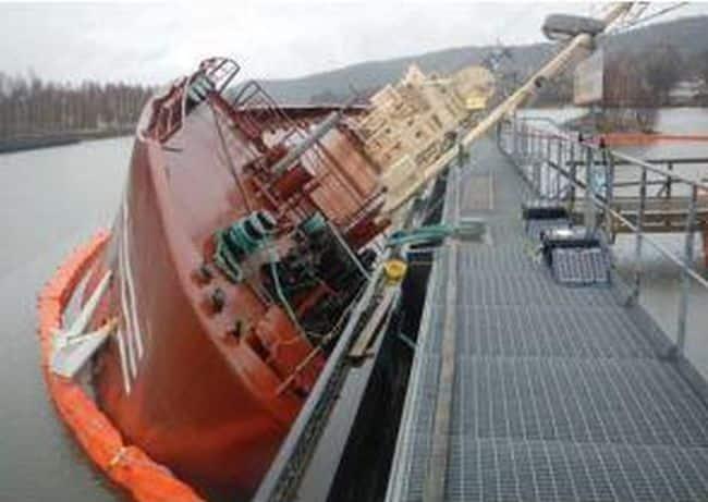 Aground, then punctured, a vessel turns sideways