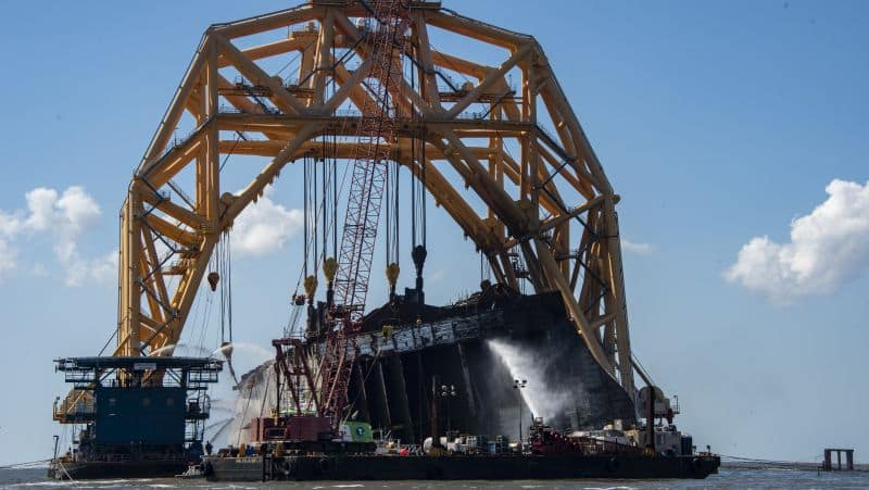 Multiple vessels cool the Golden Ray wreck using sea water on Saturday following a fire inside the